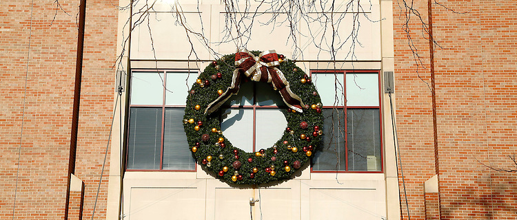 Campus holiday scenes:  Christmas wreath on the McGowan Environmental Science and Chemistry Building at 1110 W. Belden Ave, Lincoln Park Campus of DePaul University. (Photo by Jamie Moncrief)