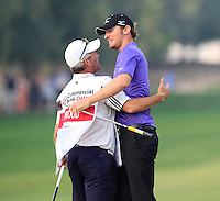 Chris Wood (ENG) hugs his caddy Brendan McCarten after sinking his eagle putt to win on the 18th green during Sunday's Final Round of the Commercial Bank Qatar Masters 2013 at Doha Golf Club, Doha, Qatar 26th January 2013 .Photo Eoin Clarke/www.golffile.ie