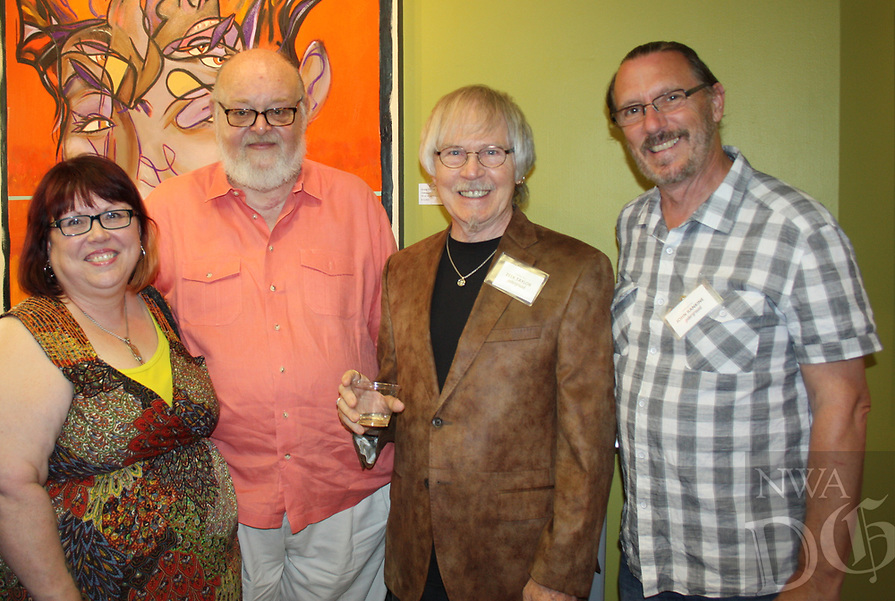 NWA Democrat-Gazette/CARIN SCHOPPMEYER Becca Martin and Gordon Spencer (from left) gather with artists Zeek Taylor and John Rankine at the Fayetteville Underground on July 6.