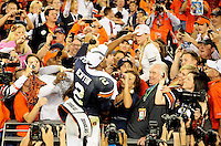 Jan 10, 2011; Glendale, AZ, USA; Auburn Tigers quarterback (2) Cameron Newton points to his father Cecil Newton (not pictured) in the grandstands following the victory over the Oregon Ducks in the 2011 BCS National Championship game at University of Phoenix Stadium.  Mandatory Credit: Mark J. Rebilas-