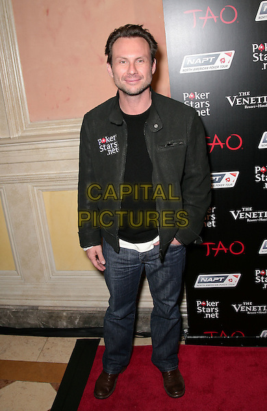 CHRISTIAN SLATER .Celebrities Come Together at Pokerstars.net NAPT Charity Tournament at the Venetian Resort Hotel and Casino, Las Vegas, Nevada 19th February 2010..full length black jacket jeans hand in pocket brown shoes .CAP/ADM/MJT.© MJT/AdMedia/Capital Pictures.