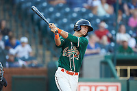 Connor Scott (23) of the Greensboro Grasshoppers follows through on his swing against the West Virginia Power at First National Bank Field on August 9, 2018 in Greensboro, North Carolina. The Power defeated the Grasshoppers 5-3 in game one of a double-header. (Brian Westerholt/Four Seam Images)