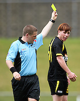 Referee Campbell Waugh yellow-cards Roddy Brown..NZFC soccer  - Team Wellington v Waikato FC at Newtown Park, Wellington. Sunday, 20 December 2009. Photo: Dave Lintott/lintottphoto.co.nz