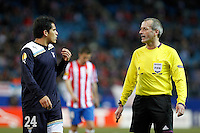 Lazio's Cristian Ledesma (l) have words with the re feree Martin Atkinson during Europa League match.February 23,2012. (ALTERPHOTOS/Acero) .Atletico Madrid Lazio Europa League.Italy Only