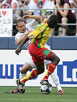 Heath Pearce (left) tries to control the ball against Cassim Langagine (right). USA defeated Grenada 4-0 during the First Round of the 2009 CONCACAF Gold Cup at Qwest Field in Seattle, Washington on July 4, 2009.