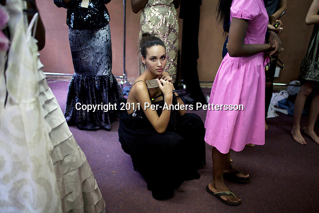 JOHANNESBURG, SOUTH AFRICA - FEBRUARY 14: A model listens to the designers for Klûk CGDT during a fitting in preparation for the Joburg Fashion Week on February 14, 2011, in Johannesburg, South Africa. Klûk CGDT, created by the designers Malcolm KLûK and Christiaan Gabriel Du Toit and their brand is not so much about clothes, but rather life and a holistic experiential, boundary blurring approach to style that encompasses all the senses. Trends influencing their collection include touches of tribal, vintage and the baroque. Their couture collection only to order. (Photo by Per-Anders Pettersson)