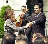Mexican singer Thalia has an impromptu dance with Bush nephew George P. Bush during the Cinco de Mayo celebration at the White House in Washington, DC on May 4, 2001.<br /> Credit: Ron Sachs / CNP