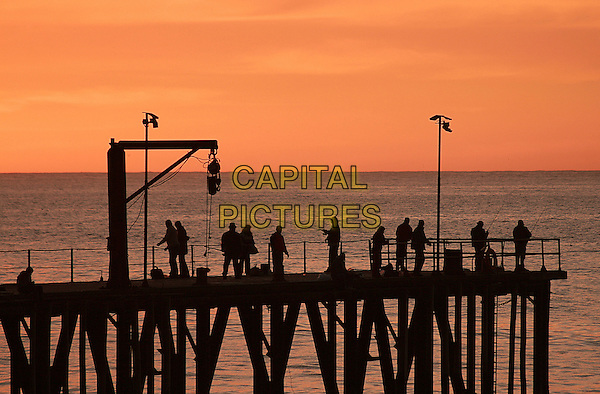 ATMOSPHERE .People fish from a dock at sunset in the historic port town of Valparaiso, Chile,.24th May 2008..pier jetty travel fisherman .CAP/GH.©Gardner Hamilton/Capital Pictures