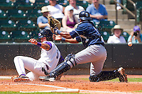 Daniel Wagner #5 of the Winston-Salem Dash slides across home plate to score a run as Jose Bonilla #9 of the Wilmington Blue Rocks can't hold on to the baseball at BB&T Ballpark on April 24, 2011 in Winston-Salem, North Carolina.   Photo by Brian Westerholt / Four Seam Images