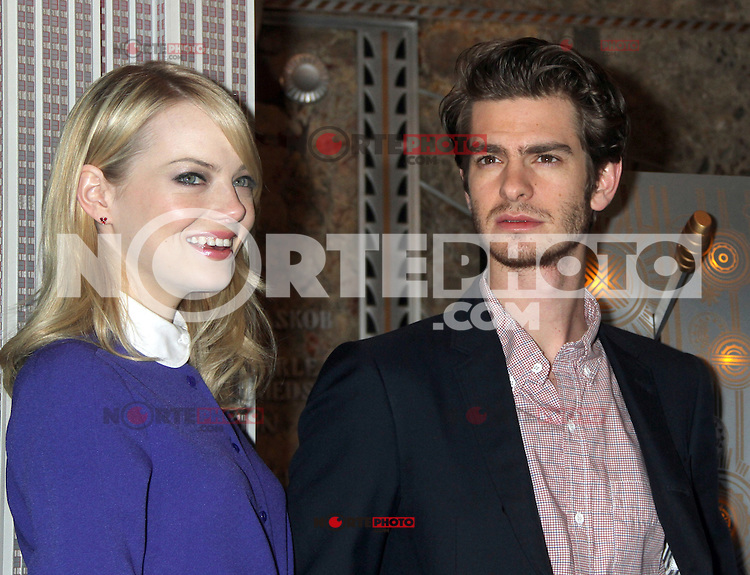 June 25, 2012 Emma Stone and Andrew Garfield, of The Amazing Spider-man film, attend the lighting ceremony  to support Stand Up to Cancer at the Empire State Building in New York City. © RW/MediaPunch Inc. **NORTEPHOTO.COM*<br />