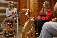 NWA Democrat-Gazette/DAVID GOTTSCHALK Amanda Quinney (from left), spins a mix of homegrown mohair and local wool with Mary Neligh, spinning rose fiber, Wednesday, February 6, 2019, during a Spin-A-Round meeting of the Wool and Wheel Handspinners in the Latta Barn at Prairie Grove Battlefield State Park. The group meets every first Wednesday of the month at the park and every third Saturday at Ozark Folkways in Winslow. The group is open to the public and invites participation and observation.