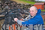 Pat Falvey, Mountain Lodge, Beaufort, examines the remains after a huge fire which destroyed his mountaineering equipment in the shed at the back of his house on Wednesday..
