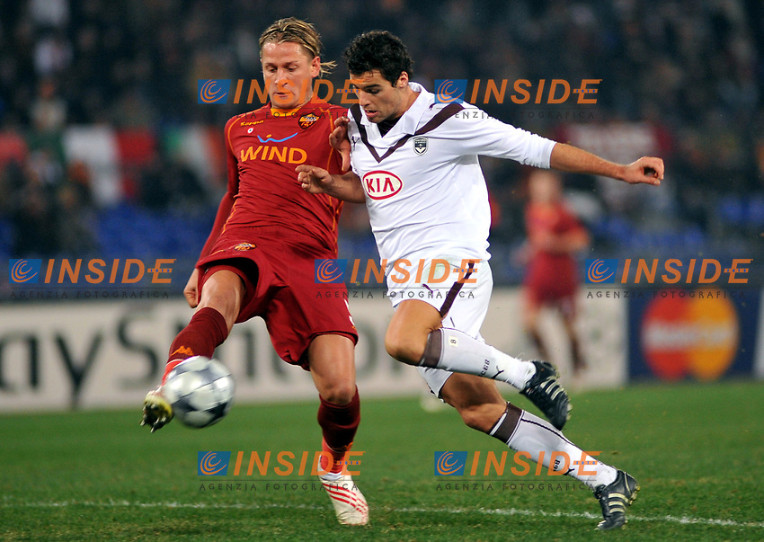 Philippe Mexes (Roma) salva in recupero su Yoann Gourcuff (Bordeaux) <br /> Roma 9/12/2008 Stadio &quot;Olimpico&quot; <br /> Champions League 2008/2009 <br /> Roma Bordeaux (2-0)<br /> Author Massimo Oliva Insidefoto