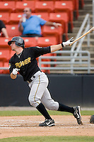 Andrew Walker #24 of the West Virginia Power follows through on his swing versus the Hickory Crawdads at L.P. Frans Stadium June 21, 2009 in Hickory, North Carolina. (Photo by Brian Westerholt / Four Seam Images)