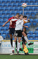 MAR 15, 2006: Faro, Portugal:  USWNT midfielder (11) Carli Lloyd collides on a header with German forward (9) Birgit Prinz and midfielder (18) Kerstin Garefrekes in the finals of the Algarve Cup in Faro, Portugal.