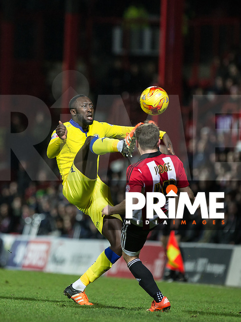 Toumani Diagouraga of Leeds United & Alan Judge of Brentford go in for the ball during the Sky Bet Championship match between Brentford and Leeds United at Griffin Park, London, England on 26 January 2016. Photo by Andy Rowland / PRiME Media Images.