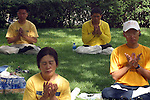 FALUN GONG MEMBERS SIT and PRAY on the PARK at DENVER.<br /> <br /> It is a movement of spirtuality that began in China in 1992 and based on the teachings and practices of both Buddhist and Taoist doctrines. Some call it a religion while others insist it's a cult.