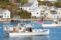 Lobster boats sit at anchor in Stonington Harbor in Stonington, Maine.