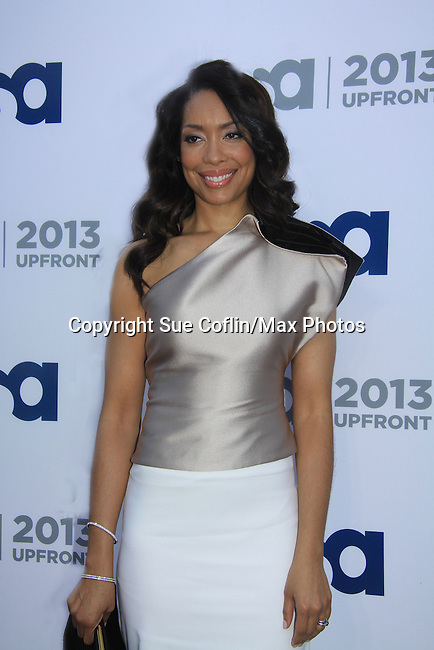 Gina Torres - Suits - USA Network's 2013 Upfront Event with actors from White Collar, Psych, Necessary Roughness, Royal Pains, Suits, Burn Notice, Covert Affairs and now joined by Modern Family on May 16, 2013 at Pier 36, New York City, New  (Photo by Sue Coflin/Max Photos)