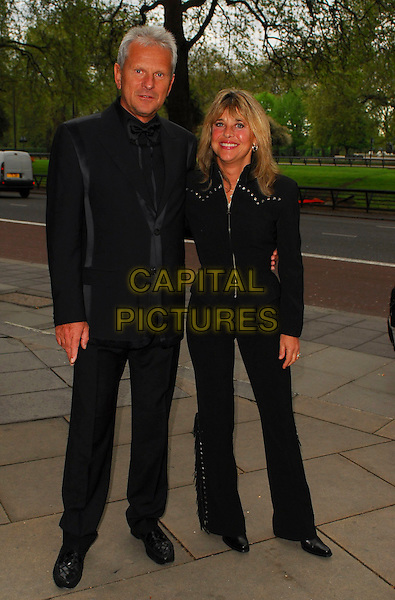 SUZI QUATRO & GUEST.Arrivals at the Sony Radio Academy Awards 2006 at Grosvenor House Hotel, London, UK..May 8th, 2006.Ref: CAN.full length black jacket trousers.www.capitalpictures.com.sales@capitalpictures.com.© Capital Pictures.