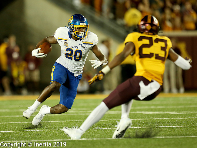 MINNEAPOLIS, MN - AUGUST 29: Pierre Strong, Jr. #20 from South Dakota State University looks to make a move against Jordan Howden #23 from the University of Minnesota during their game Thursday night at TCF Bank Stadium in Minneapolis, MN. (Photo by Dave Eggen/Inertia)