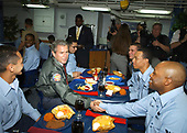 """Aboard USS Philippine Sea (CG 58) Feb. 13, 2003 -- While visiting Naval Station Mayport, Fla., President George W. Bush has lunch with Sailors stationed aboard the guided missile cruiser USS Philippine Sea.  During a speech earlier in the day, President Bush thanked Sailors and their families for their sacrifices and the continuing effort with the global war on terror.  """"The United States Navy carries the might and the mission of America to the farthest parts of the world,"""" the President said. <br /> Mandatory Credit: Chuck Hill - US Navy via CNP"""