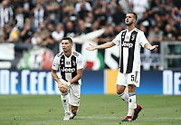 Calcio, Serie A: Juventus - Lazio, Torino, Allianz Stadium, 25 agosto, 2018.<br /> Juventus' Cristiano Ronaldo (l) and Miralem Pjanic (r) react during the Italian Serie A football match between Juventus and Lazio at Torino's Allianz stadium, August 25, 2018.<br /> UPDATE IMAGES PRESS/Isabella Bonotto