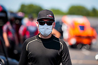 Jul 11, 2020; Clermont, Indiana, USA; NHRA funny car driver Jonnie Lindberg wears a face mask during qualifying for the E3 Spark Plugs Nationals at Lucas Oil Raceway. This is the first race back for NHRA since the start of the COVID-19 global pandemic. Mandatory Credit: Mark J. Rebilas-USA TODAY Sports