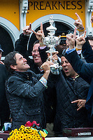 BALTIMORE, MD - MAY 21: Exaggerator trainer Keith Desormeaux holds up the trophy as he celebrates with connections after winning the 141st running of the Preakness Stakes at Pimlico Race Course on May 21, 2016 in Baltimore, Maryland. (Photo by Sue Kawczynski/Eclipse Sportswire/Getty Images)