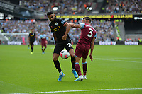 Aaron Cresswell and Riyad Mahrez of Manchester Cityduring West Ham United vs Manchester City, Premier League Football at The London Stadium on 10th August 2019