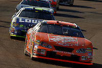 Nov 13, 2005; Phoenix, Ariz, USA;  Nascar Nextel Cup driver Tony Stewart leads Jimmie Johnson at the Checker Auto Parts 500 at Phoenix International Raceway. Tony extended his points lead going into the final race at Homestead, Fla. Mandatory Credit: Photo By Mark J. Rebilas