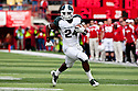 29 October 2011: Le'Veon Bell #24 of the Michigan State Spartans rushes in the fourth quarter over the left end against the Nebraska Cornhuskers at Memorial Stadium in Lincoln, Nebraska.  Nebraska defeated Michigan State 24 to 3.