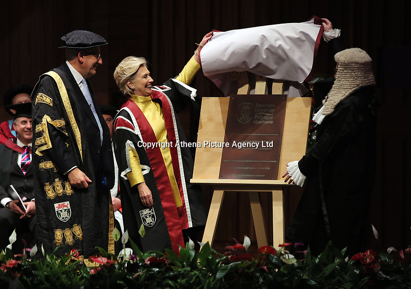 Pictured L-R: Professor Richard B Davies, Vice Chancellor of Swansea University, Hillary Clinton and Professor Elwen Evans QC, unveil a commemorative plaque at Swansea University Bay Campus. Saturday 14 October 2017<br /> Re: Hillary Clinton, the former US secretary of state and 2016 American presidential candidate will be presented with an honorary doctorate during a ceremony at Swansea University's Bay Campus in Wales, UK, to recognise her commitment to promoting the rights of families and children around the world.<br /> Mrs Clinton's great grandparents were from south Wales.