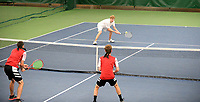 Monona Grove's Caden Nelson hits back to Sauk Prairie's Kelby Mack (left) and Noah Wankerl in the championship #1 Doubles match on Saturday, during the Badger Conference Wisconsin boys high school tennis tournament on May 18, 2019 at Nielsen Tennis Stadium in Madison, Wisconsin
