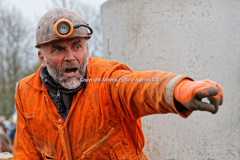 Pictured: An actor speaks to the crowd during The Man Engine show at the Copper Works in Morfa, Swansea, Wales, UK. Thursday 12 April 2018<br /> Re: The largest mechanical puppet in Britain starts its tour across south Wales.<br /> Man Engine, a mechanical miner which measures 36ft (11m) tall, has appeared at the Waterfront Museum and the former Copper Works in Swansea, Wales, animated by a dozen handlers.<br /> The giant is visiting areas linked to the nation's industrial past.