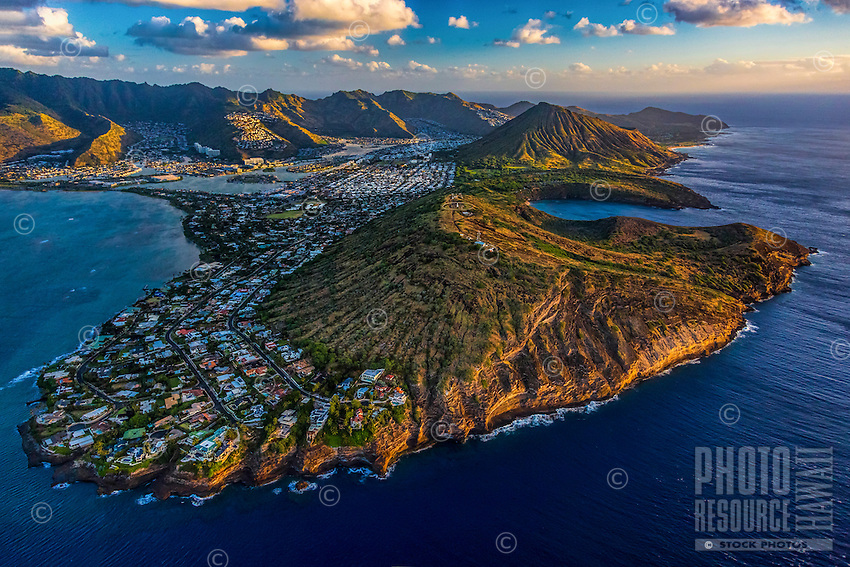 A morning bird's eye view from a helicopter of Hawai'i Kai in East O'ahu; Portlock and Koko Head are in the foreground with Hanauma Bay and Koko Crater in the distance, backed by the Ko'olau Mountains.