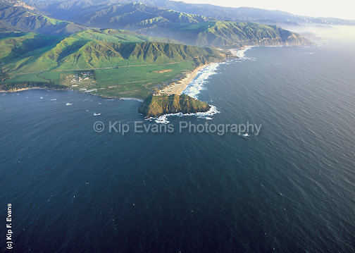 Aerial view of Point Sur and Point Sur Lighthouse along the Big Sur coast, CA