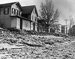 What is left of Third Street in Seymour after the flood. Houses were being marked by the State Highway Department for condemnation. 04 November 1955.