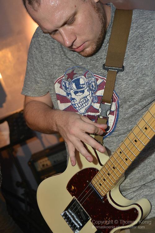 Kaohsiung, Taiwan -- Guitarist Paul Dymott of British Rock 'n' Roll band GOOBER GUN during a performance at the Brickyard.