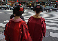 street scene with women in traditional kimono, Kyoto, Japan