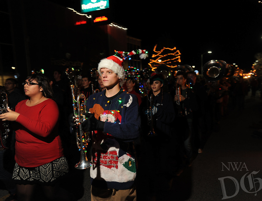 "NWA Media/ANDY SHUPE - Members of the Springdale High School band perform during the 18th annual Christmas Parade of the Ozarks Saturday, Nov. 29, 2014, on Emma Avenue in Springdale. The parade's theme was ""Silent Night"" and featured floats from area businesses and organizations."