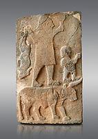 Pictures & images of the South Gate Hittite sculpture stele depicting Hittite Gods. 8th century BC. Karatepe Aslantas Open-Air Museum (Karatepe-Aslantaş Açık Hava Müzesi), Osmaniye Province, Turkey.   Against grey background