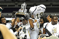 26 December 2010:  FIU wide receiver T.Y. Hilton (4) is awarded the trophy for Bowl MVP after the FIU Golden Panthers defeated the University of Toledo Rockets, 34-32, to win the 2010 Little Caesars Pizza Bowl at Ford Field in Detroit, Michigan.