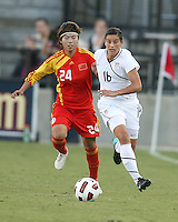 Ali Krieger #16 of the USA WNT chases after the ball with Yasha Gu #24 of the PRC WNT during an international friendly match at KSU Soccer Stadium, on October 2 2010 in Kennesaw, Georgia. USA won 2-1.