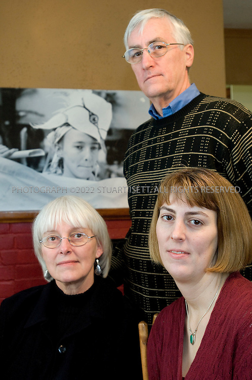 2/15/2008--Olympia, WA, USA..Rachel Corrie's parents, Cindy (left, 60) and Craig Corrie (behind, 61), as well as her older sister Sarah Corrie Simpson (right, 34), pose with a photo of Rachel behind in Sarah's home in Olympia, Washington State...Rachel Corrie killed on March 16, 2003 in Gaza, close to the border with Egypt while trying to obstruct a Caterpillar D9 armoured bulldozer, operated by the Israel Defense Forces (IDF). The circumstances and the question of responsibility for her death remain controversial..©2008 Stuart Isett. All rights reserved.