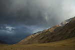 Storm clouds over mountain range, Sarychat-Ertash Strict Nature Reserve, Tien Shan Mountains, eastern Kyrgyzstan