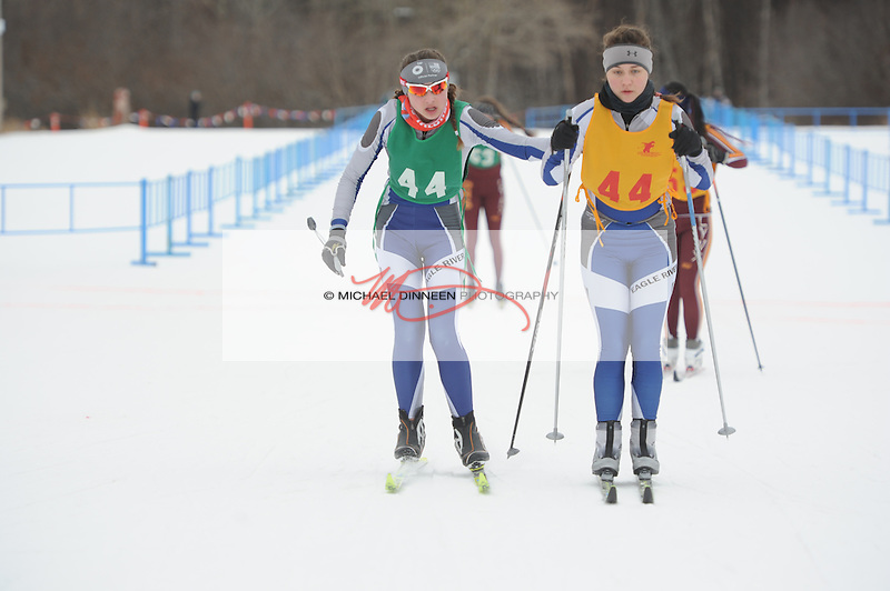 Eagle River's Myah Smith, left, tags teammate Tamara Brabson at the Region IV ski championships Saturday, Februrary 20, 2016. Photo for the Star by Michael Dinneen