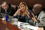 Nevada Senate Commerce committee members, from left, James Settelmeyer, R-Minden, Patriciat Farley, R-Las Vegas, and Kelvin Atkinson, D-Las Vegas, debate a move to increase Nevada's minimum wage during a hearing at the Legislative Building in Carson City, Nev., on Friday, March 20, 2015. <br /> Photo by Cathleen Allison