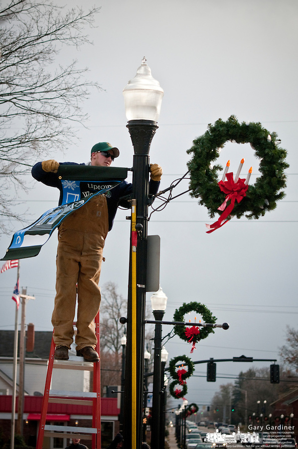 Lights and decorations are installed on the Uptown Westerville Christmas Tree  and lamp posts