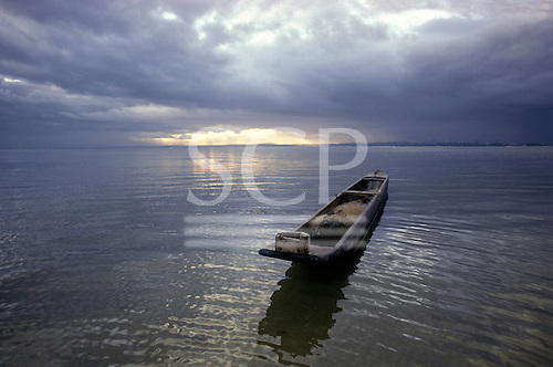 Itaparica Island, Brazil. A dugout canoe floating on a silvery sea; Bahia State.